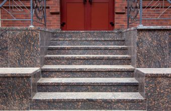 granite staircase with a rise to the front door, threshold with steps entrance close up front view.